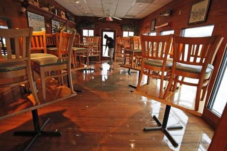 Adam Howard cleaned the inside of Bubba's restaurant in Virginia Beach, Va.